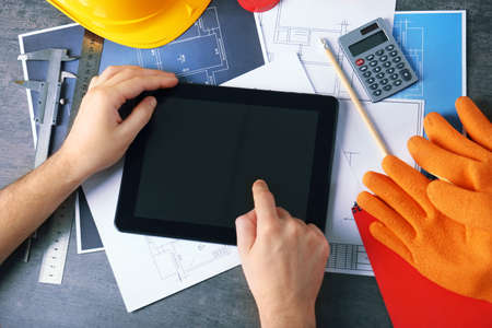 Engineer working with tablet at table