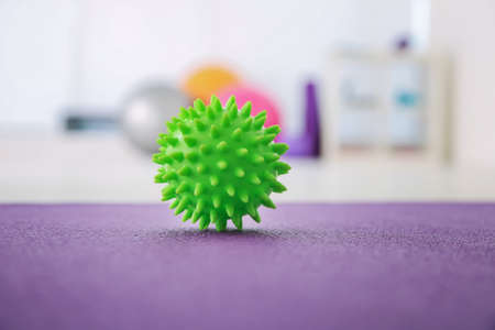 Pimply stress ball on floor in clinic Stock Photo