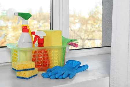 Cleaning supplies on window sill