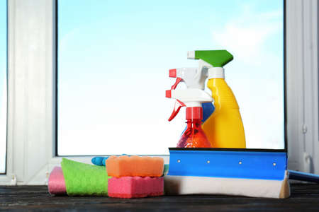 Cleaning supplies on wooden window sill