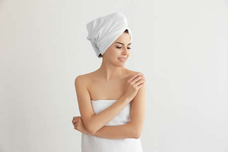Beautiful young woman after shower on light background Stock Photo