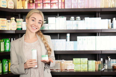 Beautiful young woman in beauty store Stock Photo