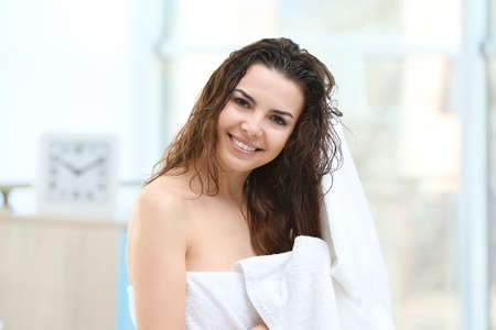 Beautiful young woman after shower at home