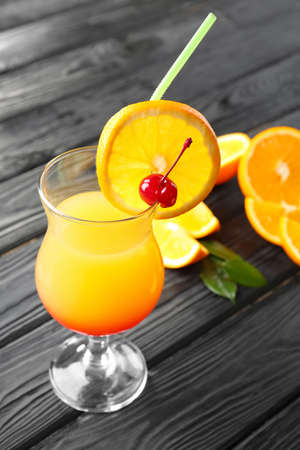 Glass of delicious tequila sunrise cocktail on table