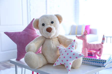 Group of cute toys on table in baby room Stock Photo