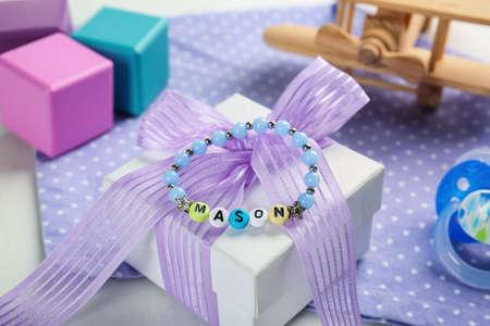 Bracelet with baby name Mason on white gift box Stock Photo