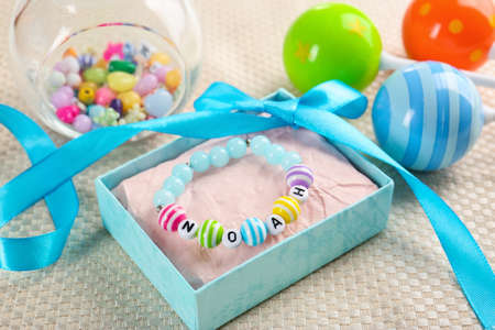Bracelet with baby name Noah in blue gift box Stock Photo