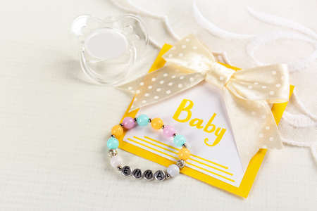 Composition with baby name bracelet on white fabric background Stock Photo