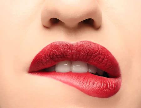 Lips of beautiful young woman, closeup
