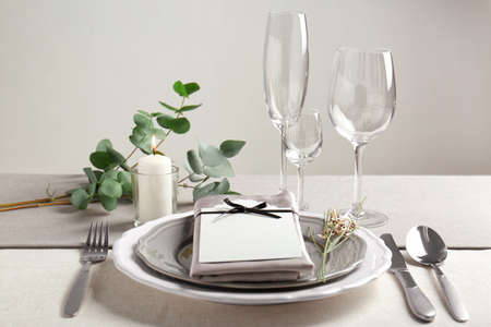 Beautiful table setting with silver flatware 写真素材