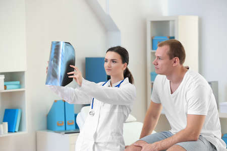 Orthopedist with patient in clinic