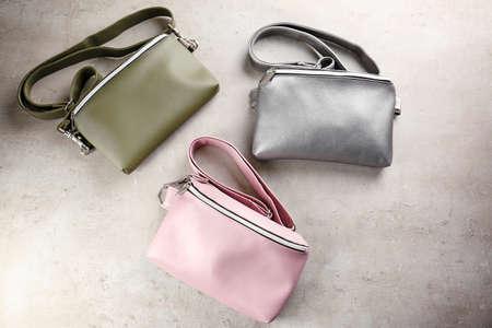 Leather handbags on light background Stock Photo