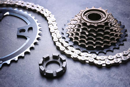 Bicycle parts on gray background
