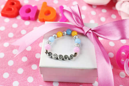 Bracelet with baby name on gift box Stock Photo