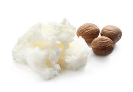 Shea butter and nuts on white background