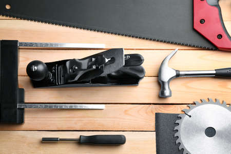 Set of carpenter's tools on wooden table