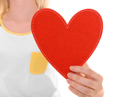 Woman holding red heart on white background. Volunteer concept