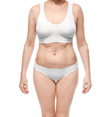 Mature woman in underwear on white background. Weight loss concept Stockfoto