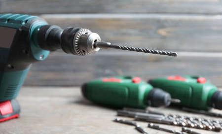 Modern drill on blurred background Foto de archivo