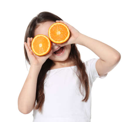 Cute little girl with halves of orange on white background