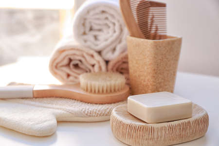 Composition with soap and bath accessories on table Stock Photo