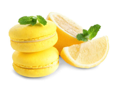 Lemon macaroons with sliced fruit and mint leaves on white background