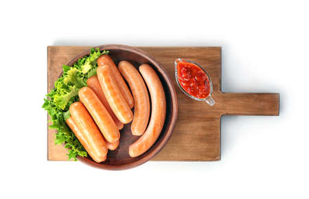 Plate with delicious grilled sausages on wooden board, isolated on white