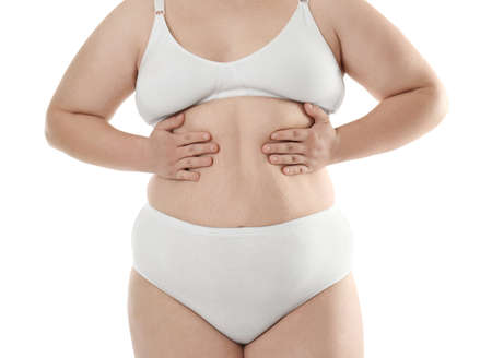 Overweight young woman in underwear on white background. Diet concept Stock Photo
