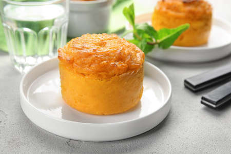 Plate with tasty carrot souffle on table Stock Photo