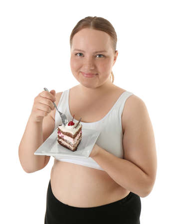 Overweight young woman with piece of cake on white background. Diet concept Stock Photo