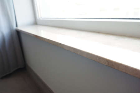Modern window sill in room, close up