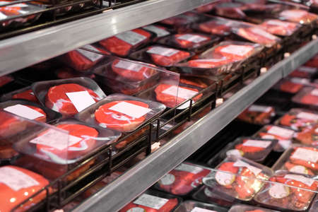 Shelves with fresh meat in supermarket