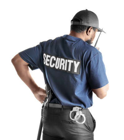 Male security guard using portable radio transmitter on white background Banque d'images