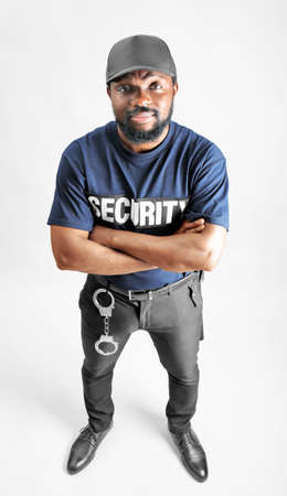 Male security guard on light background