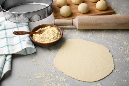 Rolled dough for tortilla on kitchen table Stock Photo
