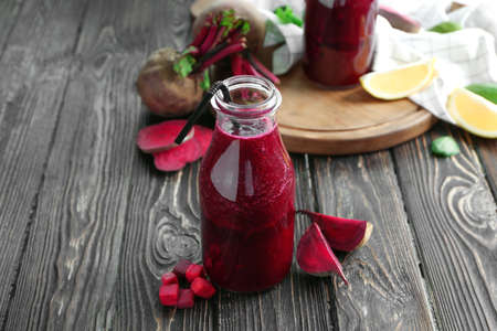 Healthy smoothie with beet root on wooden table