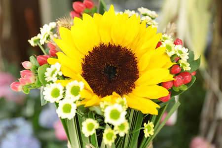 Beautiful bouquet with sunflower on blurred background