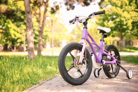 Modern childrens bicycle in park on sunny day