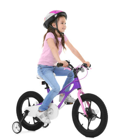 Cute little girl riding bicycle on white background