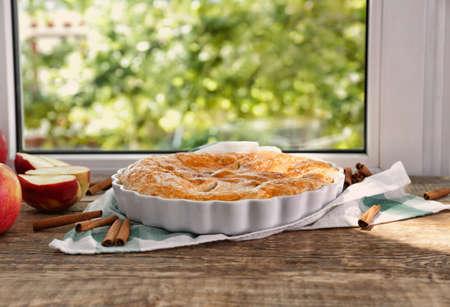 Delicious pie on windowsill Stock Photo