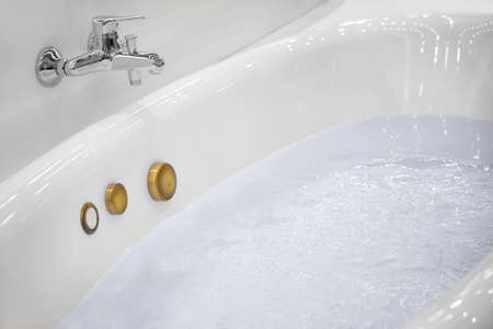New jacuzzi bathtub filled with water in store Фото со стока