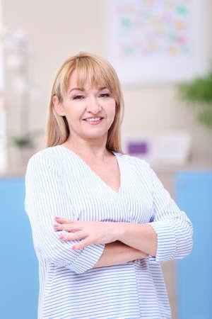 Portrait of attractive mature woman indoors Stock Photo