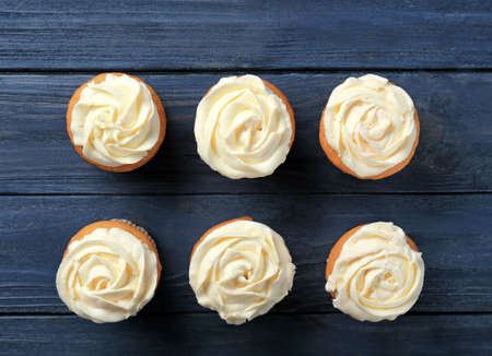 Delicious carrot muffins on wooden background