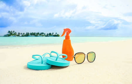 Beach accessories on sand. Summer vacation concept