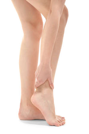 Young woman suffering from leg pain  on white background