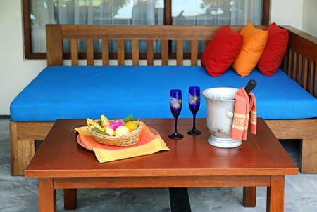 Fruits and champagne on table prepared for romantic date outdoors