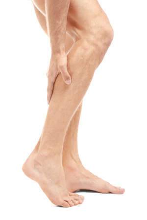 Young man suffering from pain in leg on white background 版權商用圖片 - 98222909