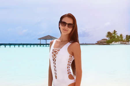 Beautiful young woman at sea resort