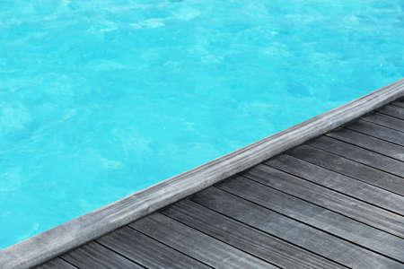 Wooden pontoon at sea resort. Summer vacation concept