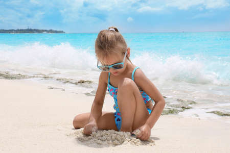 Cute little girl on sea beach 写真素材